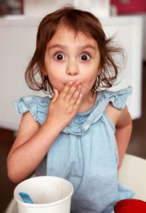 Little girl having ice cream